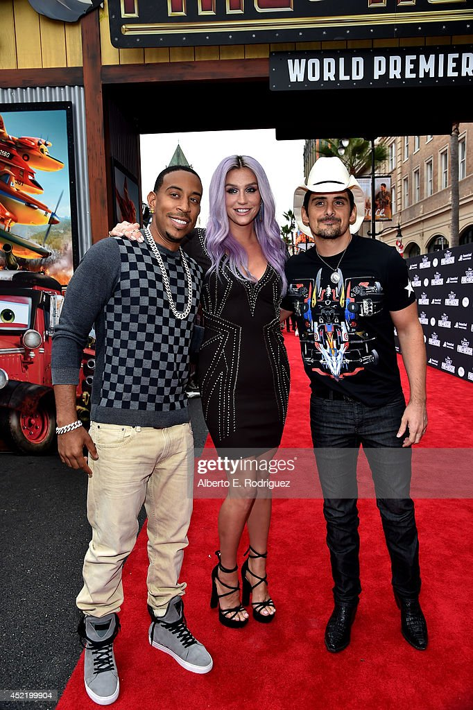 Rapper/actor <a gi-track='captionPersonalityLinkClicked' href=/galleries/search?phrase=Ludacris&family=editorial&specificpeople=203034 ng-click='$event.stopPropagation()'>Ludacris</a>, singer/songwriters Kesha and <a gi-track='captionPersonalityLinkClicked' href=/galleries/search?phrase=Brad+Paisley&family=editorial&specificpeople=206616 ng-click='$event.stopPropagation()'>Brad Paisley</a> attend World Premiere Of Disney's 'Planes: Fire & Rescue' at the El Capitan Theatre on July 15, 2014 in Hollywood, California.
