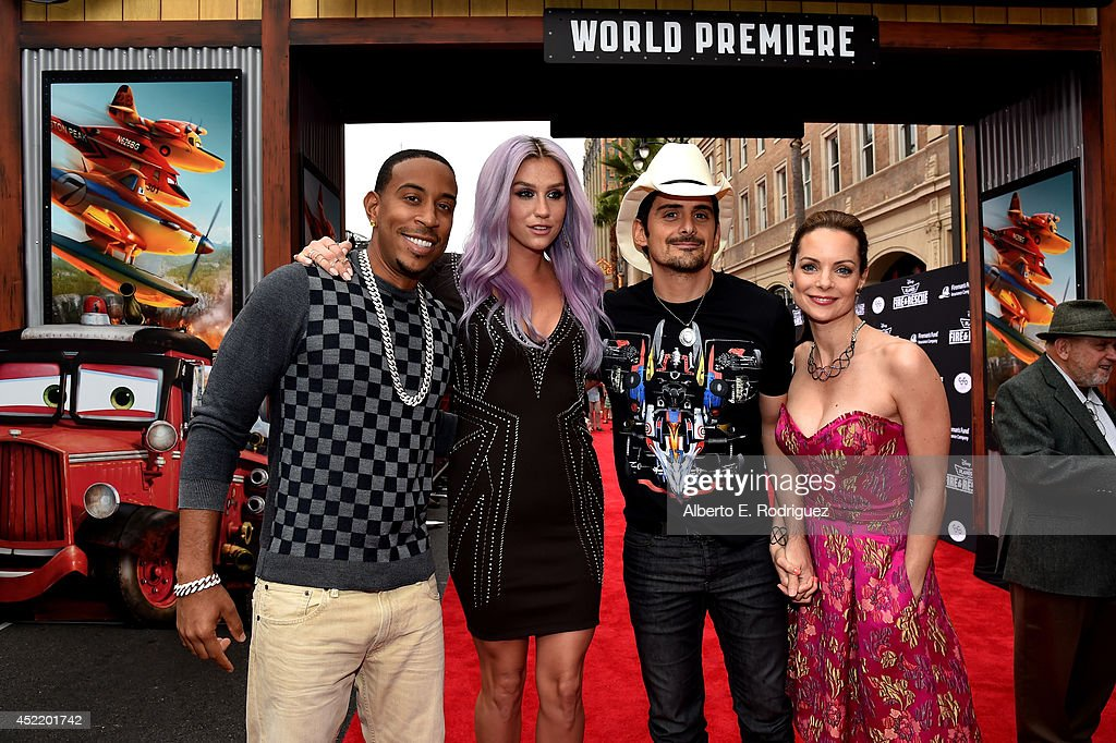 Rapper/actor <a gi-track='captionPersonalityLinkClicked' href=/galleries/search?phrase=Ludacris&family=editorial&specificpeople=203034 ng-click='$event.stopPropagation()'>Ludacris</a>, singer/songwriters Kesha,<a gi-track='captionPersonalityLinkClicked' href=/galleries/search?phrase=Brad+Paisley&family=editorial&specificpeople=206616 ng-click='$event.stopPropagation()'>Brad Paisley</a> and actress <a gi-track='captionPersonalityLinkClicked' href=/galleries/search?phrase=Kimberly+Williams-Paisley&family=editorial&specificpeople=208903 ng-click='$event.stopPropagation()'>Kimberly Williams-Paisley</a> attend World Premiere Of Disney's 'Planes: Fire & Rescue' at the El Capitan Theatre on July 15, 2014 in Hollywood, California.