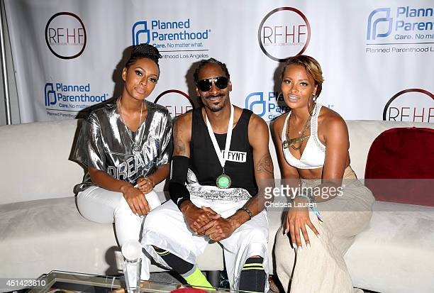 Rapper/actor Snoop Dogg and actress Eva Marcille attend Fan Fest ATT Geico Poetic Jeans Sneaker Con Tennis Xbox Health And Wellness Nickelodeon...