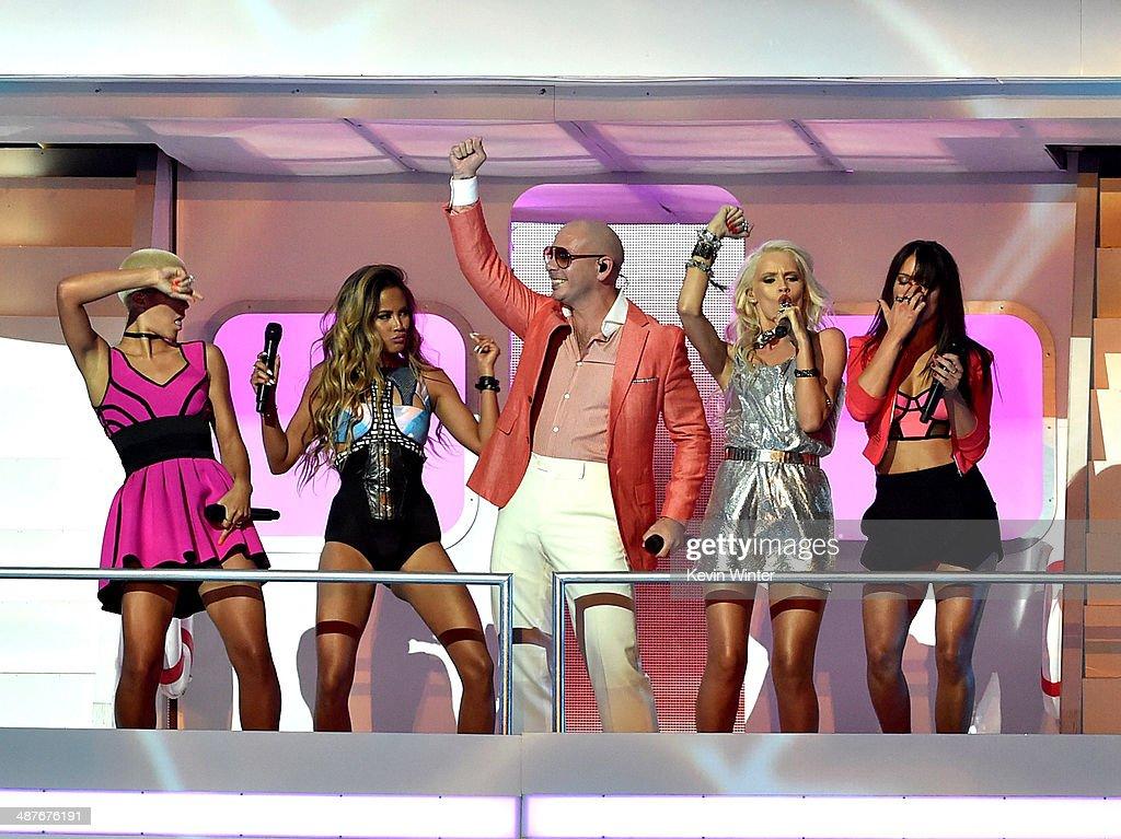 Rapper/host Pitbull and singers Paula Van Oppen Emmalyn Estrada Lauren Bennett and Natasha Slayton of GRL perform onstage during the 2014 iHeartRadio...