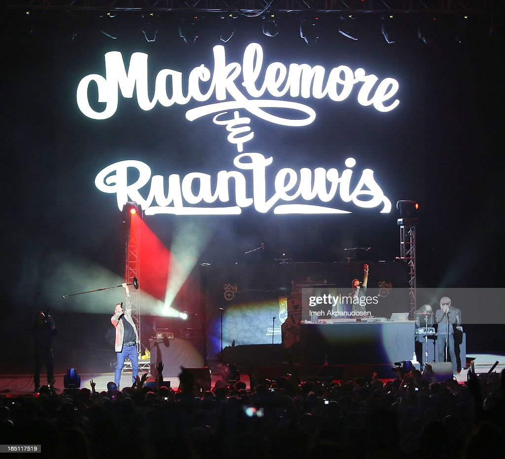 Rapper/musician Macklemore (L) and musician Ryan Lewis perform onstage during the 2013 Paid Dues Independent Hip Hop Festival at San Manuel Amphitheater on March 30, 2013 in San Bernardino, California.