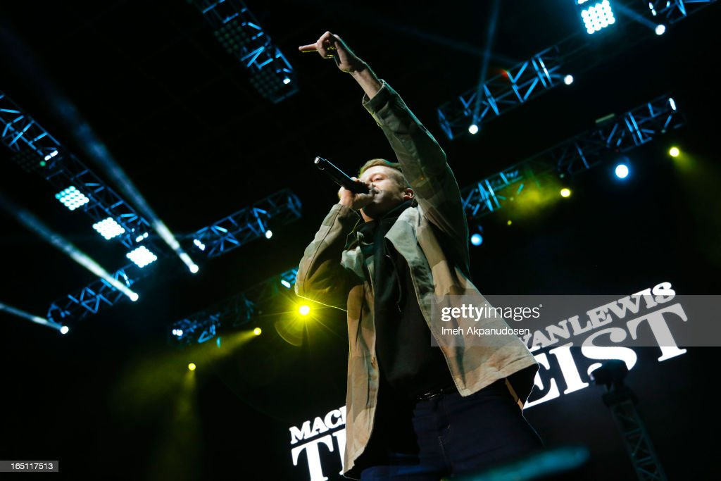 Rapper/musician Macklemore performs onstage during the 2013 Paid Dues Independent Hip Hop Festival at San Manuel Amphitheater on March 30 2013 in San...