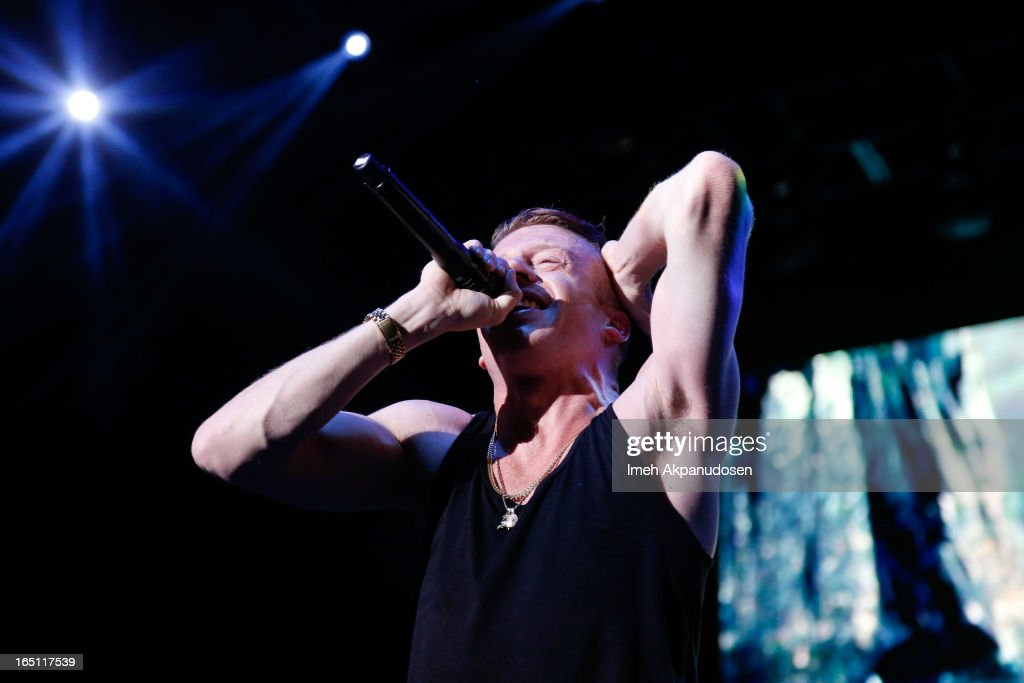 Rapper/musician <a gi-track='captionPersonalityLinkClicked' href=/galleries/search?phrase=Macklemore&family=editorial&specificpeople=7639427 ng-click='$event.stopPropagation()'>Macklemore</a> performs onstage during the 2013 Paid Dues Independent Hip Hop Festival at San Manuel Amphitheater on March 30, 2013 in San Bernardino, California.