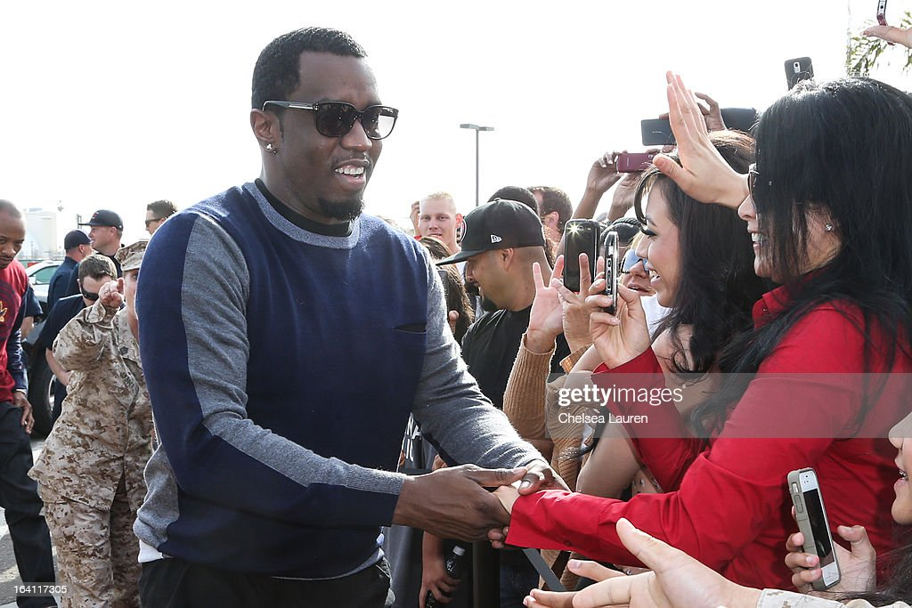 Rapper/producer/actor <a gi-track='captionPersonalityLinkClicked' href=/galleries/search?phrase=Sean+Combs&family=editorial&specificpeople=178993 ng-click='$event.stopPropagation()'>Sean Combs</a> greets fans at Ciroc and Maxim celebration of the National Day of Honor at Miramar MCX Military Base on March 19, 2013 in San Diego, California.