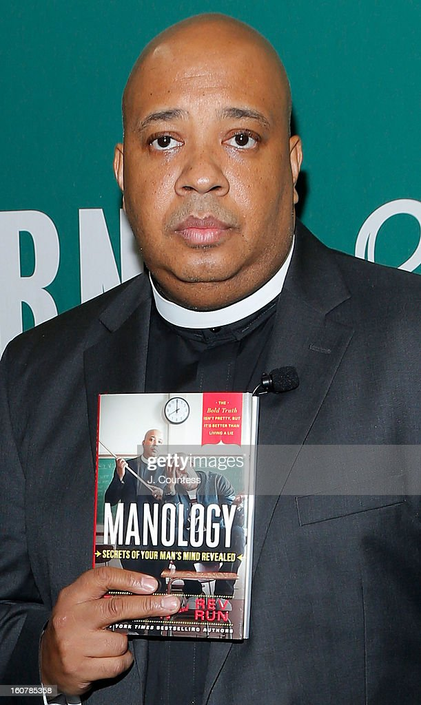 Rapper/reality television personaility Rev Run poses with a copy of his new book 'Manology: Secrets of a Man's Mind Revealed' during a book signing at Barnes & Noble Union Square on February 5, 2013 in New York City.