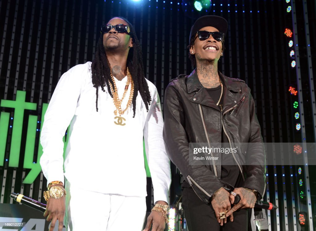 Rappers <a gi-track='captionPersonalityLinkClicked' href=/galleries/search?phrase=2+Chainz&family=editorial&specificpeople=8559144 ng-click='$event.stopPropagation()'>2 Chainz</a> and <a gi-track='captionPersonalityLinkClicked' href=/galleries/search?phrase=Wiz+Khalifa&family=editorial&specificpeople=7183449 ng-click='$event.stopPropagation()'>Wiz Khalifa</a> perform at the premiere of Universal Pictures' 'Fast & Furious 6' at Gibson Amphitheatre on May 21, 2013 in Universal City, California.