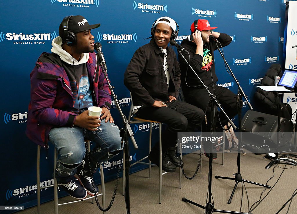 Rappers A$AP Ferg and A$AP Rocky are interviewed live on air by SiriusXM host <a gi-track='captionPersonalityLinkClicked' href=/galleries/search?phrase=DJ+Green+Lantern&family=editorial&specificpeople=2152058 ng-click='$event.stopPropagation()'>DJ Green Lantern</a> (R) at the A$AP Rocky Live Album Release Party on Hip-Hop Nation at SiriusXM Studios on January 14, 2013 in New York City.
