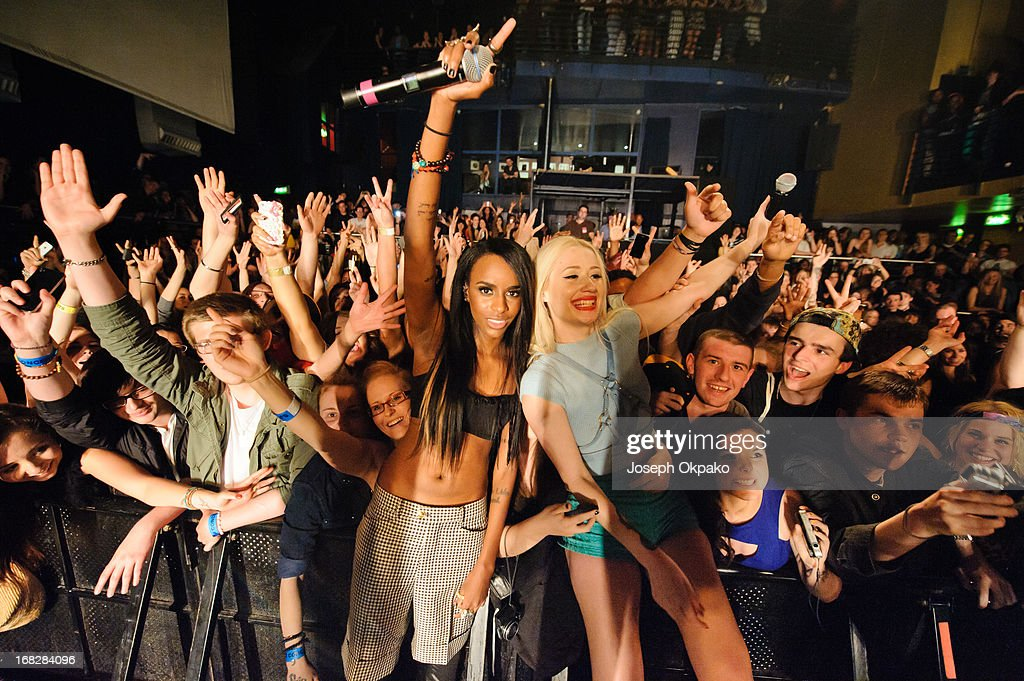 Rappers <a gi-track='captionPersonalityLinkClicked' href=/galleries/search?phrase=Angel+Haze&family=editorial&specificpeople=9771696 ng-click='$event.stopPropagation()'>Angel Haze</a> and <a gi-track='captionPersonalityLinkClicked' href=/galleries/search?phrase=Iggy+Azalea&family=editorial&specificpeople=8558263 ng-click='$event.stopPropagation()'>Iggy Azalea</a> pose with fans after performing at Scala on May 7, 2013 in London, England.