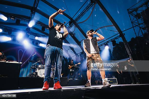 Rappers Bass Sultan Hengzt and Sido perform live on stage during 'Die Neuen Deutschpoeten Open Air Festival' at IFA Sommergarten on September 6 2014...