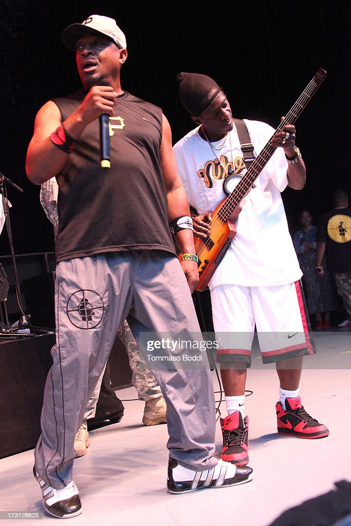Rappers <a gi-track='captionPersonalityLinkClicked' href=/galleries/search?phrase=Chuck+D&family=editorial&specificpeople=212935 ng-click='$event.stopPropagation()'>Chuck D</a> (L) and <a gi-track='captionPersonalityLinkClicked' href=/galleries/search?phrase=Flavor+Flav&family=editorial&specificpeople=171122 ng-click='$event.stopPropagation()'>Flavor Flav</a> of Public Enemy perform at the Kings Of The Mic Tour held at The Greek Theatre on July 7, 2013 in Los Angeles, California.