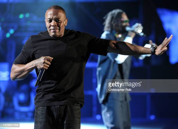 Rappers Dr Dre and Snoop Dogg perform onstage during day 3 of the 2012 Coachella Valley Music Arts Festival at the Empire Polo Field on April 15 2012...