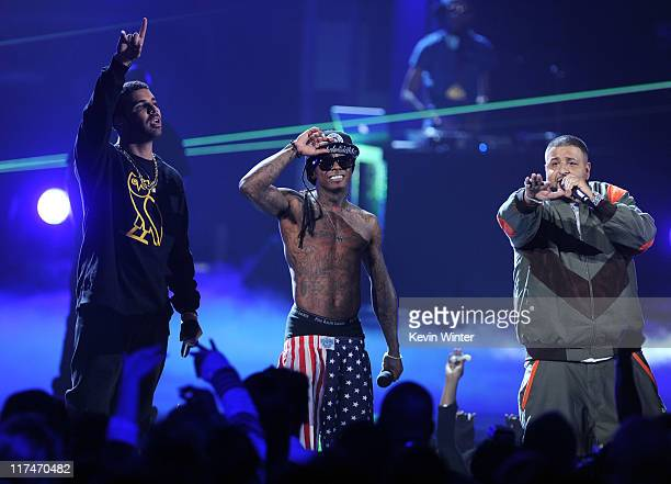 Rappers Drake Lil Wayne and DJ Khaled perform onstage during the BET Awards '11 held at the Shrine Auditorium on June 26 2011 in Los Angeles...