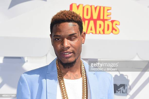 Rappers Fetty Wap poses on arrival for the 2015 MTV Movie Awards on April 12 2015 in Los Angeles California AFP PHOTO / FREDERIC J BROWN