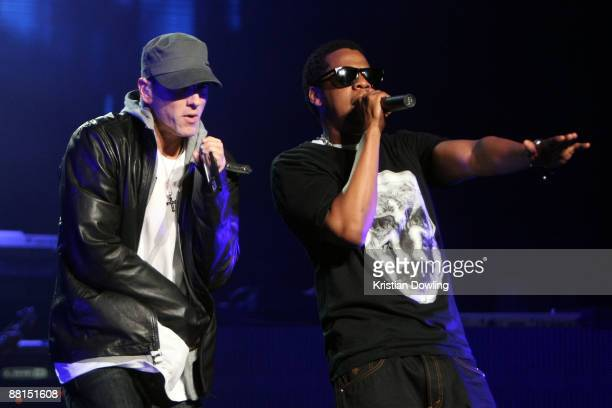 Rappers JayZ and Eminem perform together onstage at the launch of 'DJ Hero' at the Wiltern Theatre on June 1 2009 in Los Angeles California