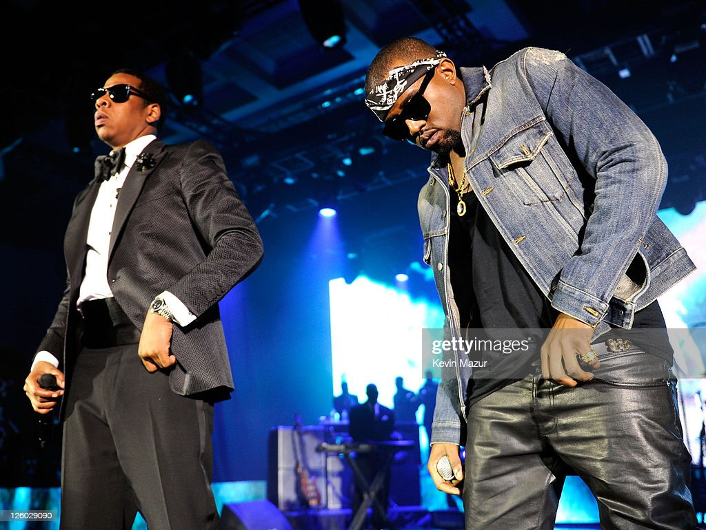 Rappers Jay-Z and Kanye West perform onstage at The Cosmopolitan Grand Opening and New Year's Eve Celebration with Jay-Z and Coldplay at Marquee Nightclub in The Cosmopolitan on December 31, 2010 in Las Vegas, Nevada.