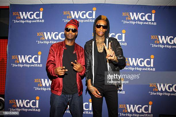 Rappers Juicy J and Wiz Khalifa poses for photos in the WGCIFM 'CocaCola Lounge' in Chicago Illinois on OCTOBER 24 2012