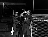 Rappers Laylaw from Above The Law and Ice Cube from NWA performs during the 'Straight Outta Compton' tour at Kemper Arena in Kansas City Missouri in...