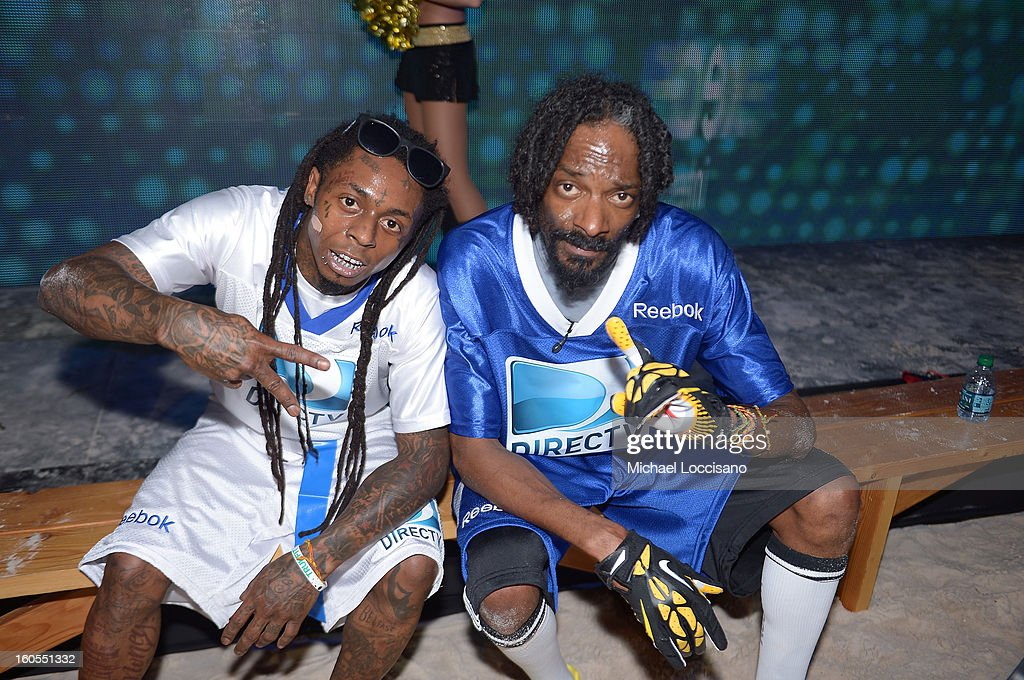 Rappers Lil Wayne (L) and Snoop Dogg attend DIRECTV'S Seventh Annual Celebrity Beach Bowl at DTV SuperFan Stadium at Mardi Gras World on February 2, 2013 in New Orleans, Louisiana.