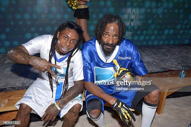 Rappers Lil Wayne and Snoop Dogg attend DIRECTV'S Seventh Annual Celebrity Beach Bowl at DTV SuperFan Stadium at Mardi Gras World on February 2 2013...