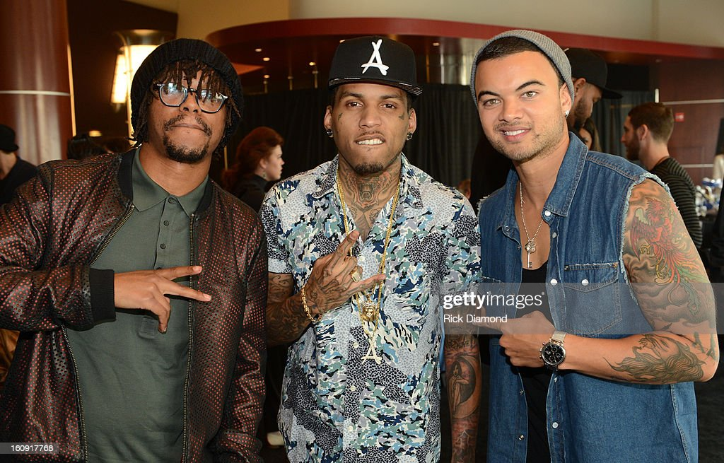 Rappers Lupe Fiasco, Kid Ink and Guy Sebastian pose backstage at the GRAMMYs Dial Global Radio Remotes during The 55th Annual GRAMMY Awards at the STAPLES Center on February 7, 2013 in Los Angeles, California.