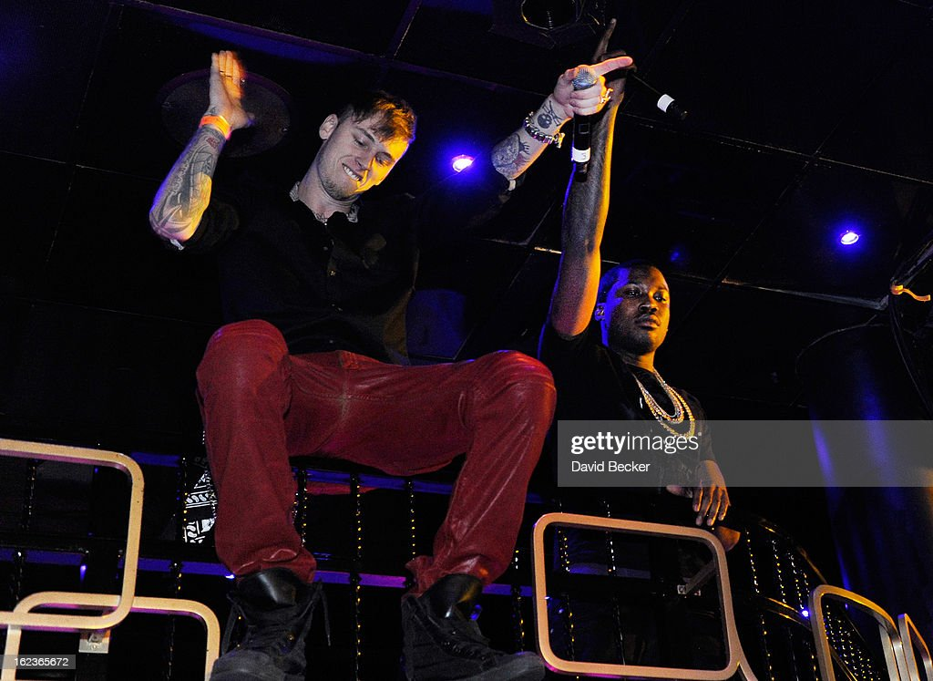 Rappers Machine Gun Kelly (L) and Meek Mill perform at the Puma party at The Bank Nightclub at the Bellagio on February 19, 2013 in Las Vegas, Nevada.