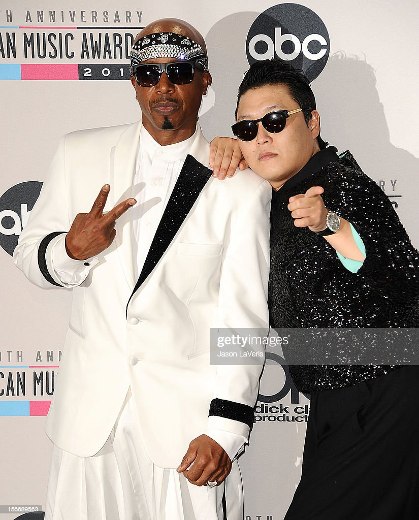Rappers MC Hammer (L) and Psy pose in the press room at the 40th American Music Awards at Nokia Theatre L.A. Live on November 18, 2012 in Los Angeles, California.