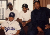 Rappers MC Ren DJ Yella EazyE and Dr Dre of the rap group NWA pose for a portrait in 1991 in New York New York DJ Yella is giving the middlefinger