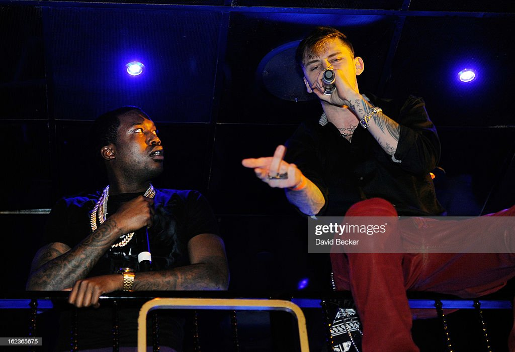Rappers Meek Mill (L) and Machine Gun Kelly (MGK) perform at the Puma party at The Bank Nightclub at the Bellagio on February 19, 2013 in Las Vegas, Nevada.