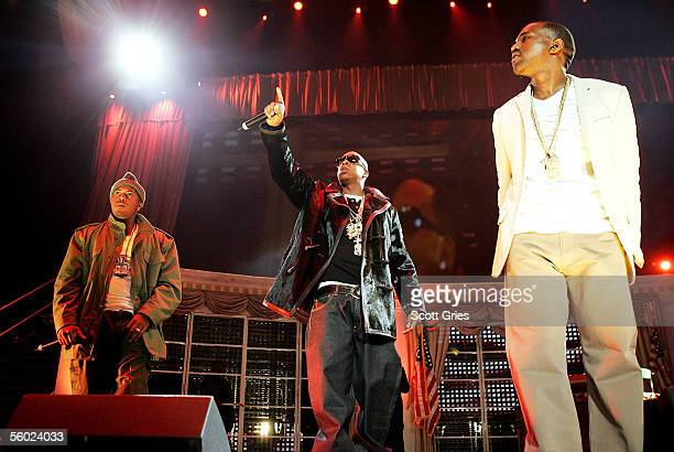 Rappers Nas JayZ and Kanye West perform onstage during Power 1051's 'Powerhouse 2005 Operation Takeover' at the Continental Airlines Arena on October...