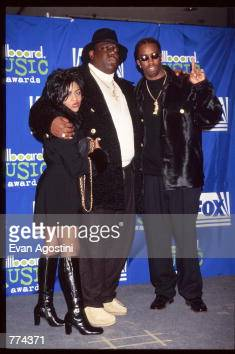 Rappers Puff Daddy and Notorious BIG stand with an unidentified female at the 1995 Billboard Music Awards December 6 1995 in New York City The awards...