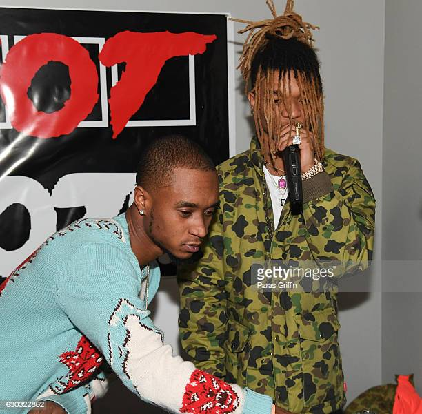 Rappers Slim Jimmy and Swae Lee of Rae Sremmurd perform onstage at 2016 Wish Fest at Andretti on December 20 2016 in Marietta Georgia