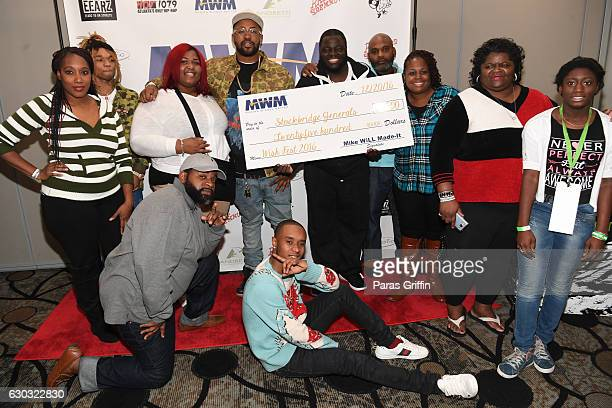 Rappers Swae Lee and Slim Jimmy of Rae Sremmurd Mike Will Made It with attendees parents at the 2016 Wish Fest at Andretti on December 20 2016 in...