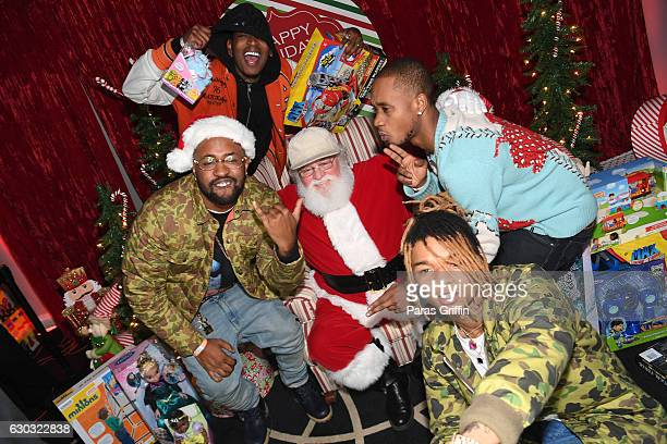 Rappers Swae Lee and Slim Jimmy of Rae Sremmurd producer Mike Will Made It and rapper Eearz with Santa Claus at the 2016 Wish Fest at Andretti on...