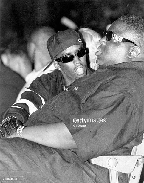 Rappers The Notorious BIG and Puff Daddy take in Dr Dre's performance at the Source Awards at the Palladium on August 3 1995 in New York New York