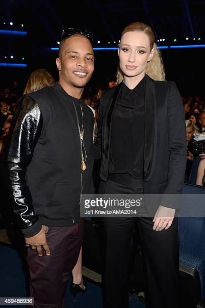 Rappers TI and Iggy Azalea attend the 2014 American Music Awards at Nokia Theatre LA Live on November 23 2014 in Los Angeles California