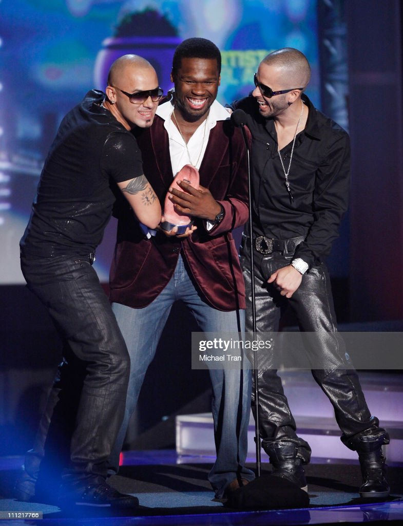 Rappers Wisin Yandel with 50 Cent onstage during the 'Los Premios MTV 2009' Latin America Awards held at Gibson Amphitheatre on October 15 2009 in...