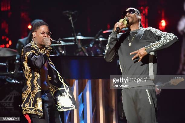 Rappers YG and Snoop Dogg perform onstage in honor of 2017 Inductee Tupac Shakur at the 32nd Annual Rock Roll Hall Of Fame Induction Ceremony at...