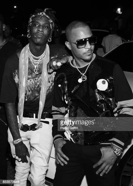 Rappers Young Thug and TI at Young Thug Private Birthday Celebration at Tago International on August 16 2017 in Atlanta Georgia