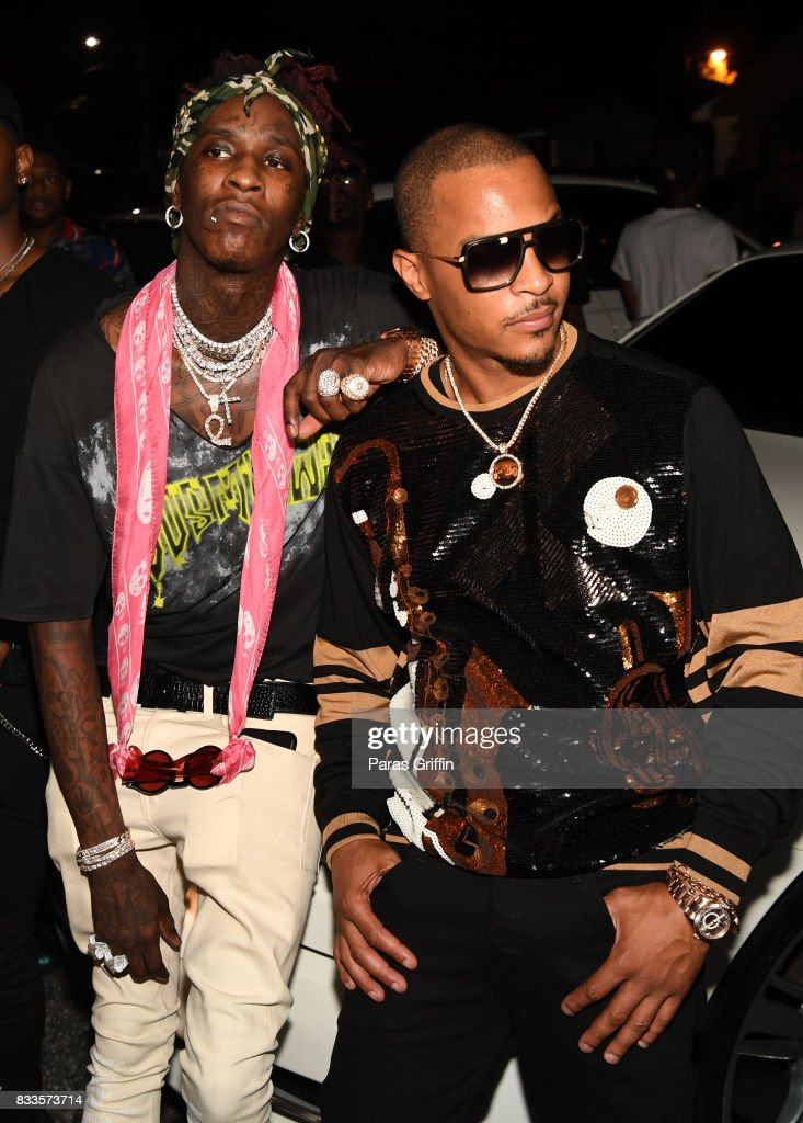 Rappers Young Thug and T.I. at Young Thug Private Birthday Celebration at Tago International on August 16, 2017 in Atlanta, Georgia.