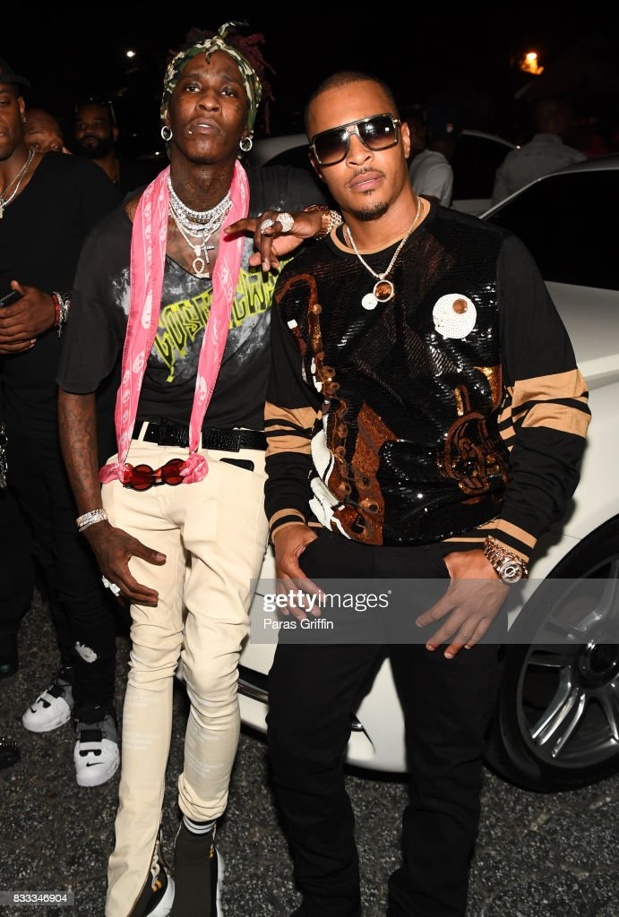 Rappers Young Thug and T.I. at Young Thug Private Birthday Celebrtation at Tago International on August 16, 2017 in Atlanta, Georgia.