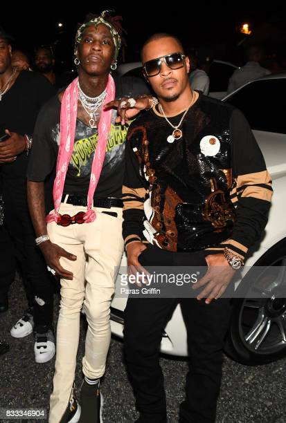 Rappers Young Thug and TI at Young Thug Private Birthday Celebrtation at Tago International on August 16 2017 in Atlanta Georgia