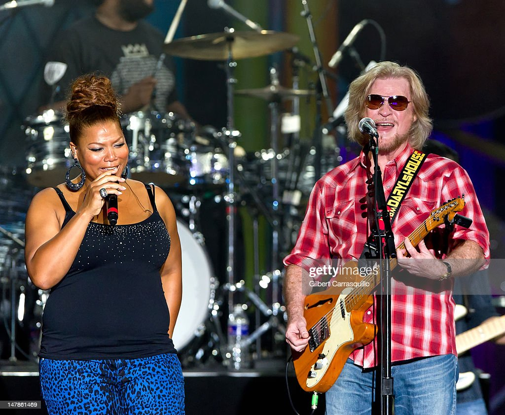 Rapper/singer and actress <a gi-track='captionPersonalityLinkClicked' href=/galleries/search?phrase=Queen+Latifah&family=editorial&specificpeople=171793 ng-click='$event.stopPropagation()'>Queen Latifah</a> and musician <a gi-track='captionPersonalityLinkClicked' href=/galleries/search?phrase=Daryl+Hall&family=editorial&specificpeople=215308 ng-click='$event.stopPropagation()'>Daryl Hall</a> perform at the Philly Fourth Of July Jam at Benjamin Franklin Parkway on July 4, 2012 in Philadelphia, Pennsylvania.