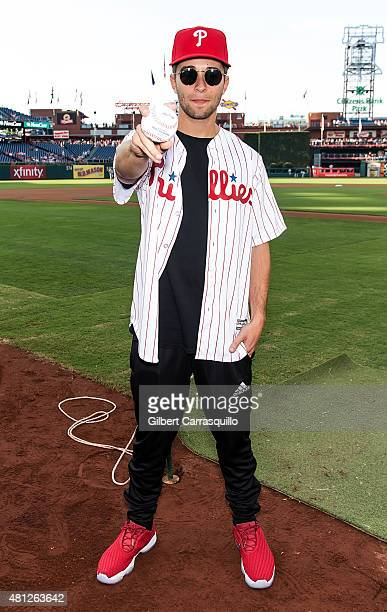 Rapper/songwriter Jake Miller throws the first pitch at the Miami Marlins Vs Philadelphia Phillies Game at Citizens Bank Park on July 18 2015 in...