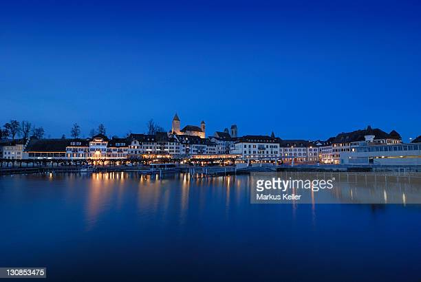 Rapperswil - the promenade and the Rapperswil castle at dawn - Canton of St. Gallen, Switzerland, Europe.