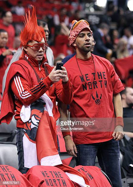 Raptor fans watch the warmup prior to play between the Brooklyn Nets and the Toronto Raptors in Game Seven of the NBA Eastern Conference...
