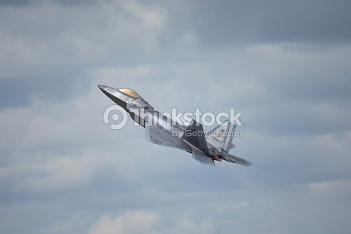 F22 Raptor In A High G Maneuver With Condensation Trails Forming