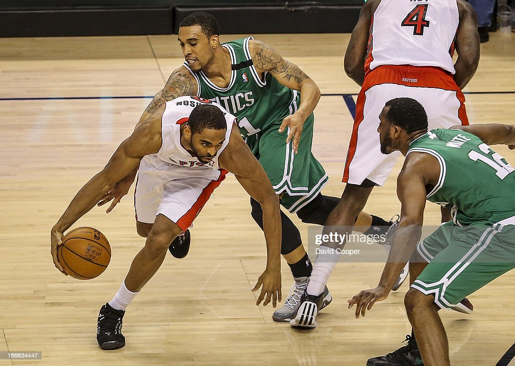Raptors  Alan Anderson (6) is guarded closely by Celtics Courtney Lee (11)