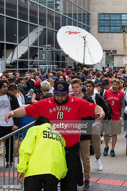 Raptors basketball team fans cross security measures at the entrance of 'Jurassic Park' zone for game 3 of the Eastern Conference Finals against the...