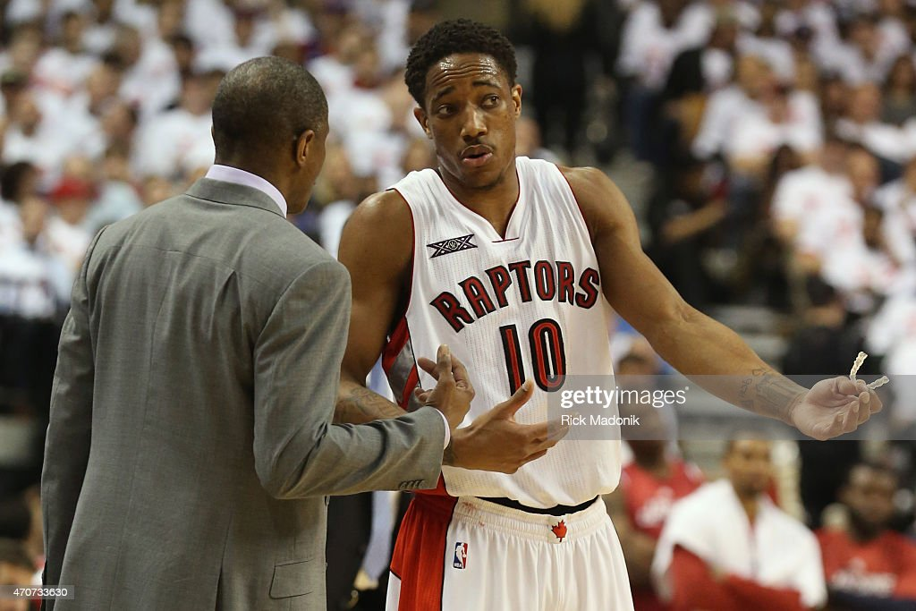 TORONTO APRIL 21 Raptors DeMar DeRozan and coach Dwayne Casey chat along the sideline Toronto Raptors vs Washington Wizards during 1st half action at...