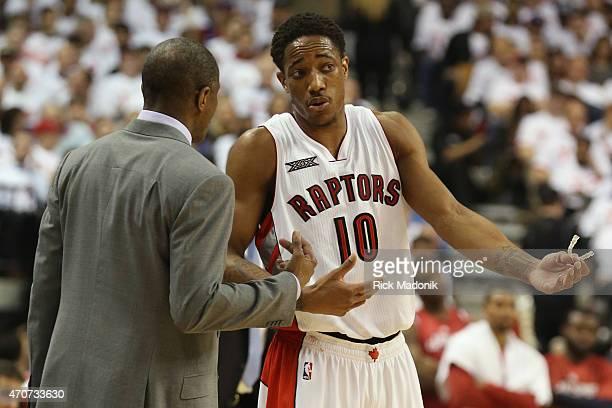 TORONTO APRIL 21 Raptors DeMar DeRozan and coach Dwayne Casey chat along the sideline Toronto Raptors vs Washington Wizards during 1st half action at...